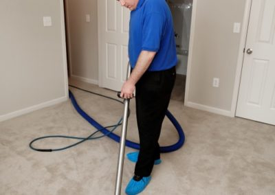 Man cleaning carpet with commercial cleaning equipment
